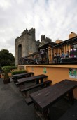 Bunratty Castle and Durty Nelly pub in Bunratty village, Ireland