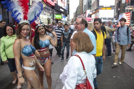 new york city, 12 september 2015: two almost naked girls talk to