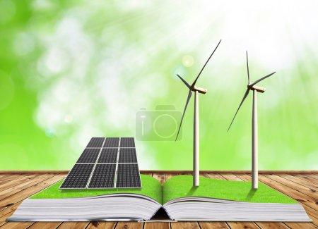 Foto de Libro ecológico con panel solar y aerogeneradores. Concepto de energía limpia . - Imagen libre de derechos