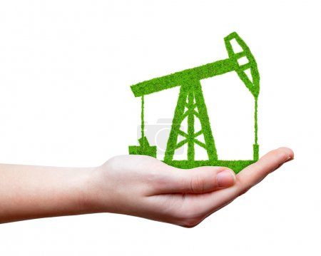 Green oil pump in hand