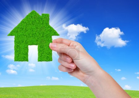 Foto de Casa verde en la mano - Imagen libre de derechos