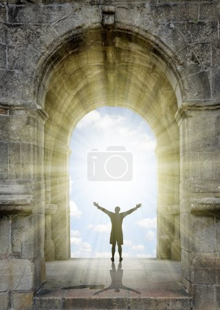 Photo for Man standing in front of the gate to heaven. - Royalty Free Image