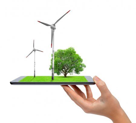 Foto de Tableta digital de mano con aerogeneradores y árbol aislado sobre fondo blanco - Imagen libre de derechos