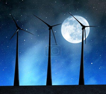 Foto de Wind turbines in the night sky with moon. - Imagen libre de derechos