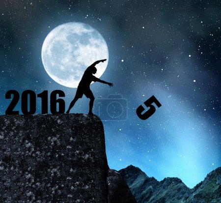 Photo for Silhouette of man throws fives. Concept New Year 2016 - Royalty Free Image