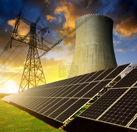 Solar energy panels, nuclear power plant and electricity pylon
