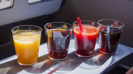 Berlin, Germany, on March 30, 2011. Various drinks in plastic glasses offered in flight to passengers of AirBerlin airline