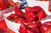 Fresh ripe strawberry on a market counter