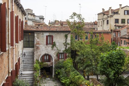 VENICE, ITALY - on MAY 1, 2015. House. A view from the window in a typical Venetian court yard