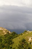 Photo of the hilly area with stormy sky