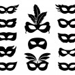 Set of carnival mask silhouettes isolated on white...