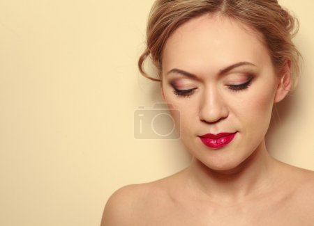 Portrait of beautiful woman with hairstyle and makeup