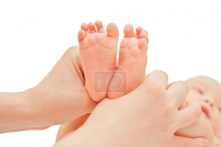 Picture of baby footstep with moms hands