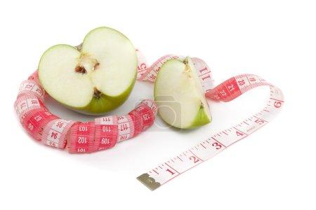 Photo pour Image de pomme verte et ruban à mesurer - image libre de droit
