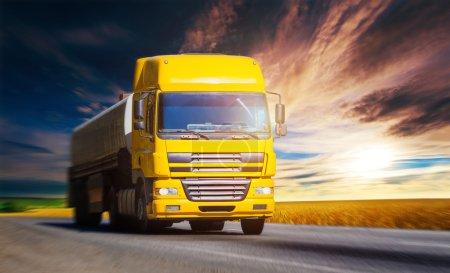 Yellow truck on highway