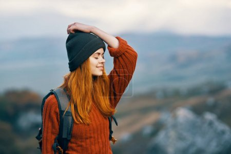 Cheerful woman hiker mountains nature landscape tr...