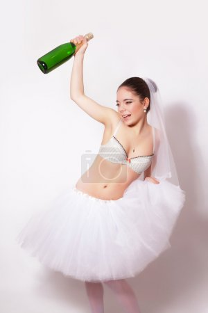 Merry bride with a bottle of champagne in hand