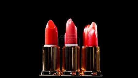 shades of different lipsticks isolated on black