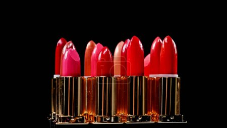 set of different lipsticks isolated on black