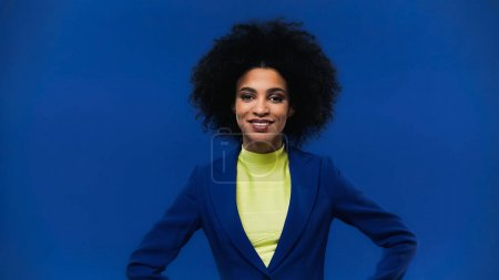 African american woman smiling at camera isolated on blue