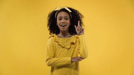 amazed african american girl having idea isolated on yellow