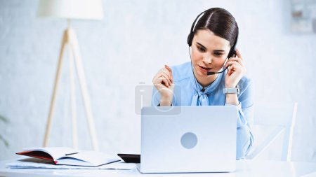 young call center operator working near laptop in office