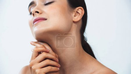 young woman with perfect skin posing with closed eyes isolated on white