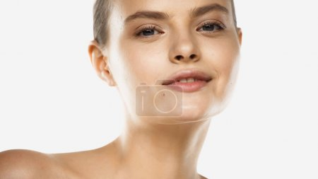 young woman with perfect skin looking at camera and smiling isolated on white