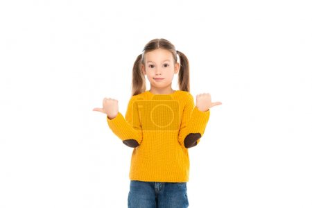 Confused kid pointing away while looking at camera isolated on white