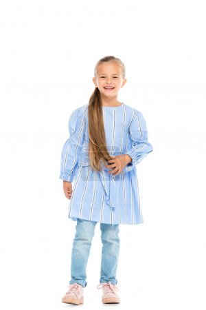 Photo for Cheerful girl in dress and jeans looking at camera on white background - Royalty Free Image