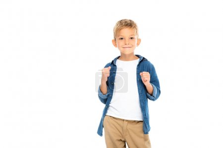 Smiling boy showing yeah gesture isolated on white