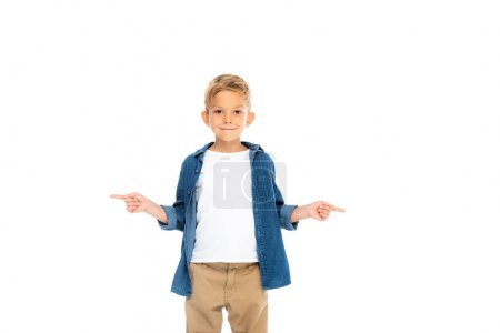 Smiling kid pointing with fingers isolated on white