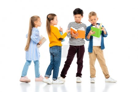 Photo for Multiethnic kids holding colorful books on white background - Royalty Free Image