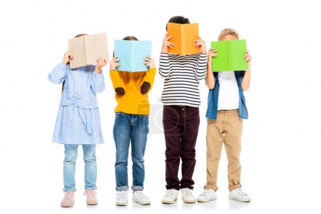 Photo for Kids holding colorful books near faces on white background - Royalty Free Image