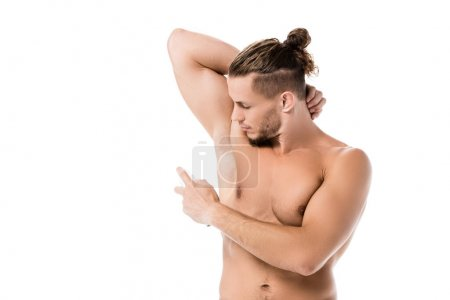 sexy shirtless man using deodorant isolated on white