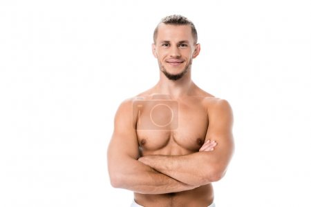 Photo for Smiling sexy shirtless man posing with crossed arms isolated on white - Royalty Free Image