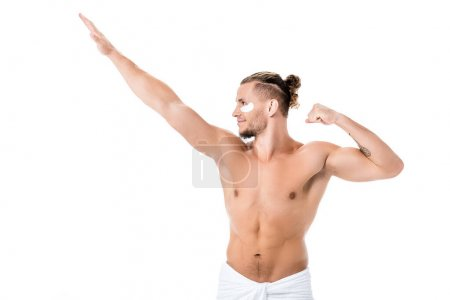 Photo for Sexy shirtless man in towel with eye patches on face showing muscles isolated on white - Royalty Free Image