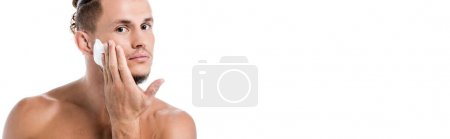 sexy shirtless man applying foam on face isolated on white, banner