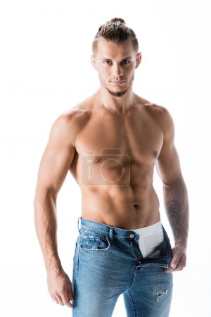 Photo for Sexy shirtless man in jeans posing isolated on white - Royalty Free Image