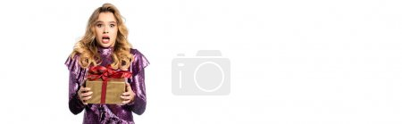 shocked elegant woman in sequin dress with gift box isolated on white, banner