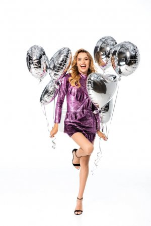 happy elegant woman in sequin dress with silver balloons isolated on white
