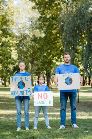 family of volunteers holding placards with there is no planet b inscription, ecology concept