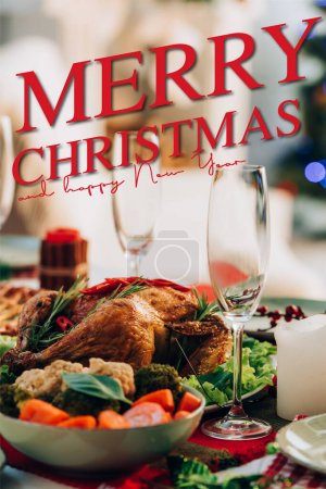 table served with delicious turkey and vegetables near merry christmas and happy new year lettering and glasses