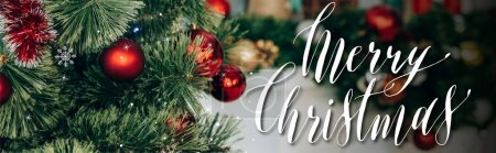Photo for Decorated pine branches with red balls near merry christmas lettering, banner - Royalty Free Image