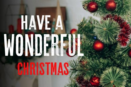 Photo for Pine branches near decorated fireplace and have a wonderful christmas lettering - Royalty Free Image