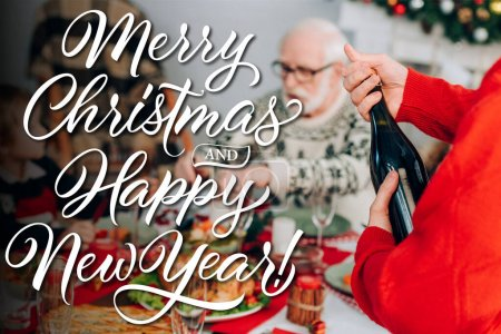 Photo for Man opening champagne bottle near family and festive table, merry christmas and happy new year illustration - Royalty Free Image