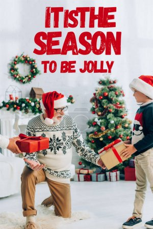 Photo for Grandfather in santa hat taking gifts from grandchildren on christmas, it is season to be jolly illustration - Royalty Free Image