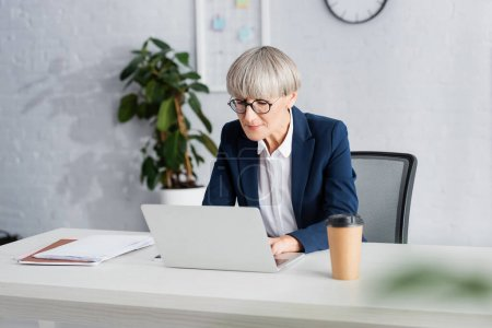 Photo for Mature team leader in glasses working in office - Royalty Free Image