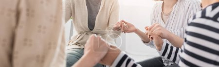 Photo for Partial view of women holding hands during seminar, banner - Royalty Free Image