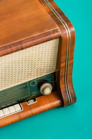 close up view of vintage radio receiver on turquoise